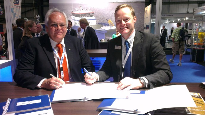 Nick Jeffery, General Manager of Solent Towage Limited and MD, John Spencer, Damen signing the contract.